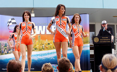 15 JUL 2006 TOWNSVILLE, QLD - Motorsport fans converged on Townsville's Entertainment & Convention Centre for the launch of the Lexmark Indy 300.  Reigning Miss Indy Jana Peterson (centre) shows her winning smile as she parades with 2006 contestants  (from left) Kayci Brunker, Sarah Gleeson, Katie Miller & Jessica Passmore - PHOTO: CAMERON LAIRD