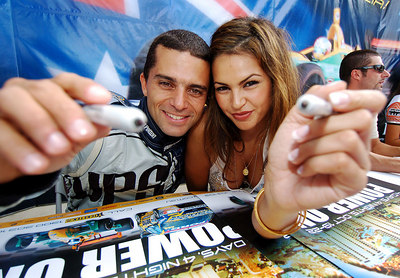 "15 JUL 2006 TOWNSVILLE, QLD - Motorsport fans converged on Townsville's Entertainment & Convention Centre for the launch of the Lexmark Indy 300.  V8 Supercar driver Max Wilson and ""The Pleasure Machine"" Gabrielle Richens sign autographs - PHOTO: CAMERON LAIRD"