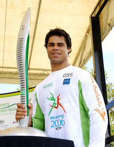 TOWNSVILLE, QLD / 04 FEB 2006 - The Queens Baton Relay visits Townsville.  North Queensland Cowboys winger Matt Sing at Townsville's Strand Park - PHOTO: CAMERON LAIRD