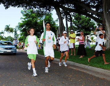 TOWNSVILLE, QLD / 04 FEB 2006 - The Queens Baton Relay visits Townsville.  North Queensland Cowboys winger Matt Sing and local sports champion Rachel Dillon run along Townsville's Strand - PHOTO: CAMERON LAIRD