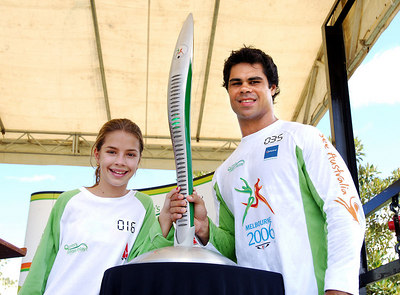 TOWNSVILLE, QLD / 04 FEB 2006 - The Queens Baton Relay visits Townsville.  North Queensland Cowboys winger Matt Sing and local sports champion Rachel Dillon on Townsville's Strand - PHOTO: CAMERON LAIRD
