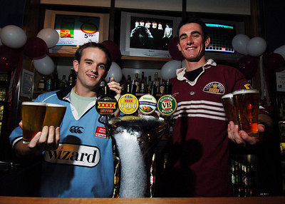 14 JUN 2006 TOWNSVILLE, QLD - State of Origin celebrations at Townsville's Riverview Tavern.  Barmen Adrian McMahon and Gerard Fitzgerald - PHOTO: CAMERON LAIRD (Ph: 0418 238811)