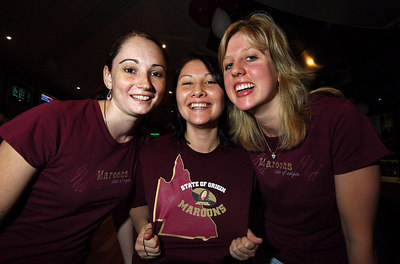 14 JUN 2006 TOWNSVILLE, QLD - State of Origin celebrations at Townsville's Riverview Tavern.  (from left) Christine McAuliffe, Kimberley Cerney and Lauren McKenzie support their team - PHOTO: CAMERON LAIRD (Ph: 0418 238811)