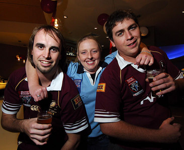 14 JUN 2006 TOWNSVILLE, QLD - State of Origin celebrations at Townsville's Riverview Tavern.  Catherine Deeks tackles Maroons fans Chippy Slater (left) and Michael Douglas (right) - PHOTO: CAMERON LAIRD (Ph: 0418 238811)