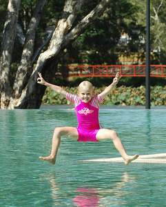 08 JUL 2006 TOWNSVILLE, QLD - Bronte Aitken, 5, enjoys a dip in the lagoon at Thuringowa River Festival 2006, a nine day program celebrating the opening of the Thuringowa Riverway project - PHOTO: CAMERON LAIRD