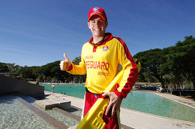 08 JUL 2006 TOWNSVILLE, QLD - Lifeguard Cameron Tod gives his approval of the lagoon at Thuringowa River Festival 2006, a nine day program celebrating the opening of the Thuringowa Riverway project - PHOTO: CAMERON LAIRD