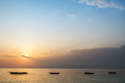 Four Boats at Sunset