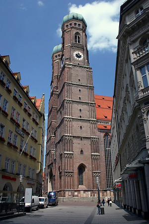 Between the buildings along Liebfrauenstrasse (Lady Street) - to the twin copper-domed brick towers of the Fruenkirche (Church of Our Lady), rising to 325 ft. (99 m) - Munich