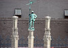 Oxidized statue atop the limestone spire of the Neues Rathaus (New Town Hall) - Munich