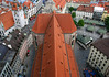 View from atop the St. Peter's Church tower - down the clay tile roof of the nave, to the north and south transepts - Munich