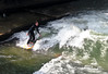 """River Surfing"" the Eisbach (Ice Brook) - a small man-made river, and tributary of the Isar River - that flows through the Englischer Garten (English Garden) Park - Munich"