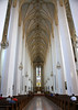Eastward view along the main nave, supported by the 72 ft. (22 m) tall columns - with the chandeliers and crucifix suspended from the Gothic style ribbed vault - Frauenkirche (Church of Our Lady) - Munich