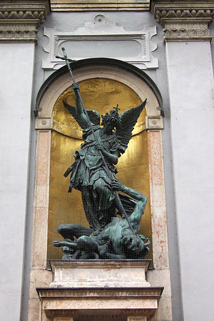 Archangel Michael fighting for the Faith and killing the Evil in the shape of a humanoid demon - statue upon the facade of the St. Michael's Church - Munich
