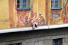 Allegoric mural and 3-D appendage of a cherub (child angel) - on the Altes Rathaus (Old Town Hall) - Bamberg