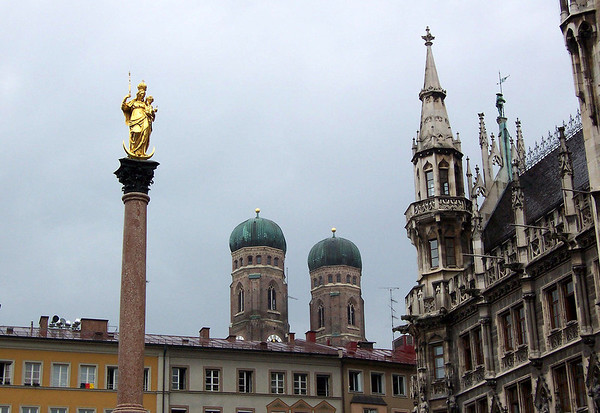 Beyond the Mariensäule (St. Mary's Column) and the southwestern spire of the Neues  Rathaus (New Town Hall) - to the twin brick towers and oxidized copper domes of Frauenkirche (Church of Our Lady) - Munich