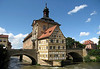 "Altes Rathaus (Old Town Hall) - in 1467 it was rebuilt with its Gothic architecture influence, but in 1756 the building received Baroque touches - located on an island in the Regnitz River, and connected by two bridges (the Obere Brücke, ""Upper Bridge"", seen here and completed in 1455) - Bamberg"