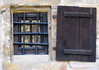 Window of the Imperial Cathedral, with wooden shutter and metal security bars - Bamberg