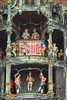 """Glockenspiel (Carillon) - the upper revolving figurines enacts the 1568 marriage of the local Duke Wilhelm V to Renata of Lorraine - and the lower story enacts the Schäfflerstanz (""""coopers dance"""") during the plague of 1517 - Munich"""