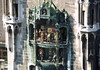 """Glockenspiel (Carillon) - the upper revolving figurines enacts the 1568 marriage of the local Duke Wilhelm V to Renata of Lorraine - and the lower story enacts the Schäfflerstanz (""""coopers dance"""", a cooper is one who makes wooden barrels), according to myth, 1517 was a year of plague in Munich, and the coopers are said to have danced through the streets to, """"bring fresh vitality to fearful dispositions."""" The coopers remained loyal to the duke, and their dance came to symbolize perseverance and loyalty to authority through difficult times - Munich"""