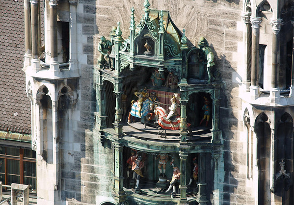 """Glockenspiel (Carillon) - the upper revolving figurines enacting a joust at the 1568 marriage of the local Duke Wilhelm V to Renata of Lorraine - and the lower story enacts the Schäfflerstanz (""""coopers' dance""""), during the plague of 1517 - Munich"""