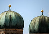 The oxidized octagonal copper domes, atop the towers (325 ft. - 99 m) of the Frauenkirche (Church of Our Lady) - Munich