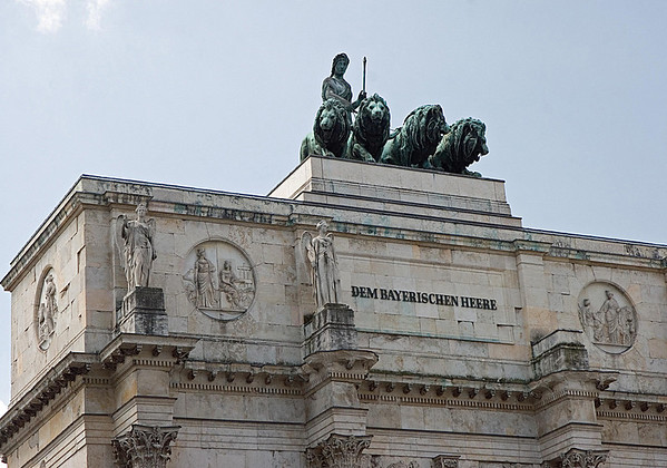 """Atop the Sigestor (Victory Gate) - the winged statues, symbolizing victory - and bas-reliefs depicting battle scenes - with a bronze statue of Bavaria (a female personification of the Bavarian homeland, and by extension its strength and glory) with a lion-quadriga (lions were used pulling the chariot instead of horses, because the lion was the iconic symbol of the """"House of Wittelsbach"""", the ruling family of the Bavarian monarchy from 1180-1918) - Munich"""