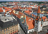 Northeast view across Munich - from atop the St. Peters Church - to the clock tower and spire of the Altes Rathaus (Old Town Hall) and beyond.