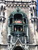 Glockenspiel (Carillon) - a set of tuned bells in the upper tower, synchronized with revolving life-size figurines depicting stories - situated on the Neues Rathaus Turm (New Town Hall Tower) - Munich