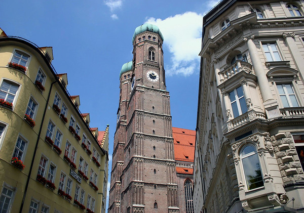 """Between the buildings along Liebfrauenstrasse (Lady Street) - to the twin domed towers of the Fruenkirche (Church of Our Lady) - also referred to as, Dom zu unserer lieben Frau, """"Cathedral of Our Dear Lady"""" - Munich"""