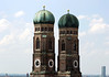 Twin brick towers (Romanesque style) and oxidized copper domes (Renaissance style) - the domes were not completed until 1525 (due to lack of funds, which were originally designed to be Gothic spires) and the towers of the Frauenkirche (Church of Our Lady) was completed in 1488 - Munich