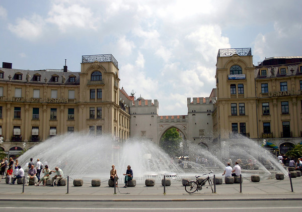 Fountain at Karlsplatz (also called Stachus) - a city square created by Karl Theodor (the Elector of the Holy Roman Empire from 1777-1799) - with the Karlstor (Karls Gate) beyond the fountain, which leads into the historic city of Munich.