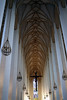 Westward view along the main naive - with the suspended crucifix and chandeliers from the ribbed vault - Frauenkirche (Church of Our Lady) - Munich