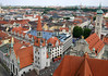 From atop the tower at the St. Peters Church, with the eastern roof transepts - viewing northeast over the tower and spire of Altes Rathhaus (Old Town Hall) - across the the Munich skyline.