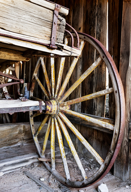 Closeup of wheel and corner of carriage, Bodie, California USA.