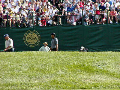 Tiger Woods and Mark O'Meara on hole 18 green