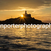 A golden Bracelet Bay looking at Mumbles Lighthouse, Gower, South Wales.