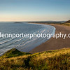 Rhossili Bay in the evening yellow glow of setting sun, Gower, South Wales.