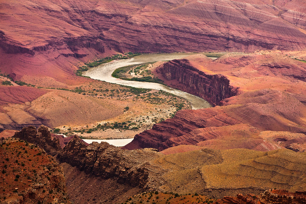 Rains bring out the deep red colors below the rim of the Grand Canyon