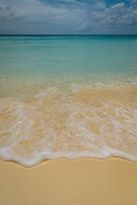 Seafoam Gently Rolls Up The Beach