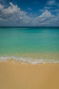 Small Wave Crashing In Paradise
