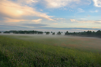 A misty morning over the mixed grass prairies of eastern Kansas at sunrise.