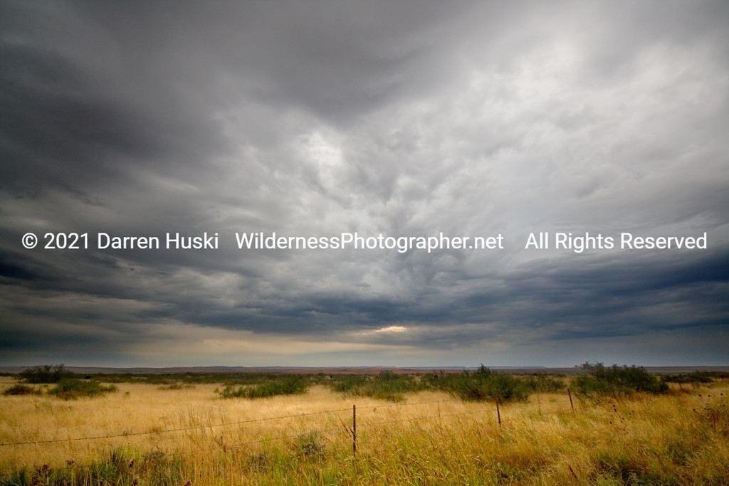 Moody skies above new Mexico at the edge of the high plains country.