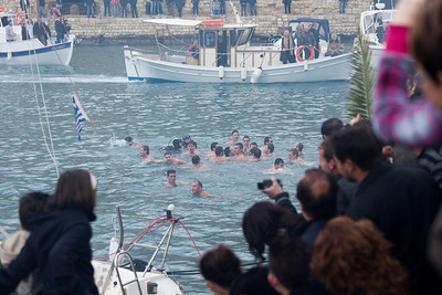 Swimmers compete for a crucifix hurled into the water by a priest during the Blessing of the Waters Ceremony, Epiphany Holiday, Iraklio, Crete, Greece