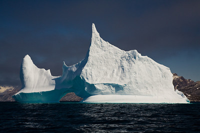 Iceberg under low clouds.