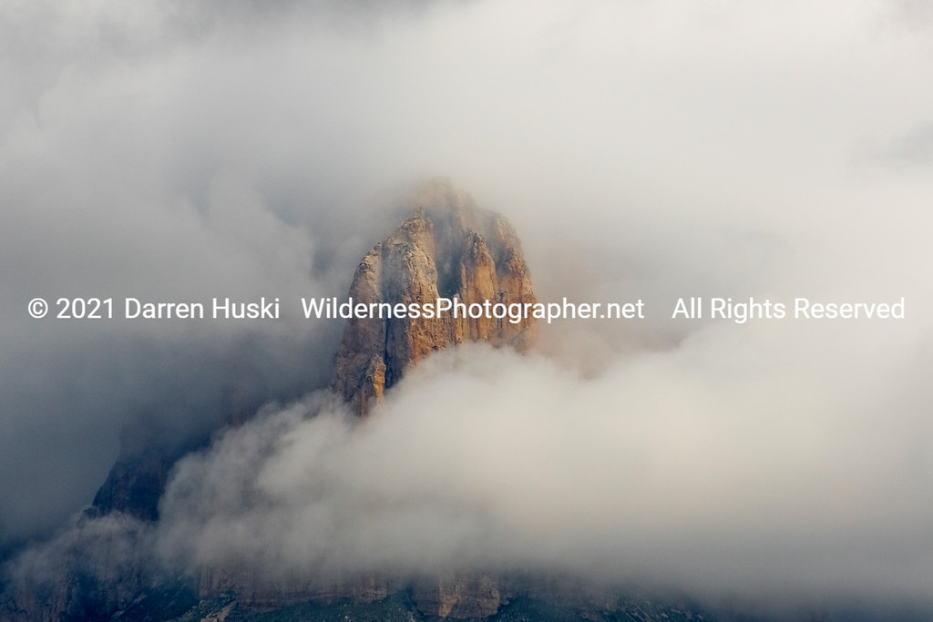 The prow of El Capitan in the clouds.