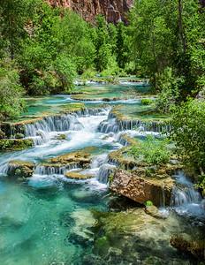 Cool blue green waters cool the cayon floor at Havasu Falls