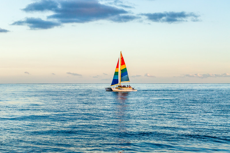 A Colorful Sailboat on a Pacific Ocean Dusk