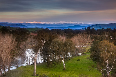 The Australian Snowy Mountains over the Mighty Murray River at Sunset.  Pop in to the Jingellic Pub for a hot chocolate, then continue down the dirt road on the NSW side towards Tintaldra.