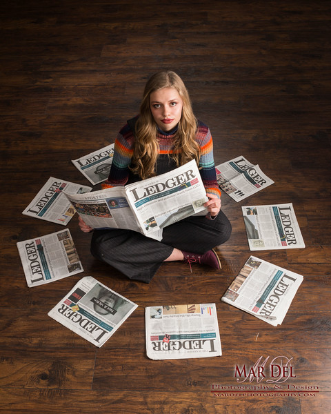 Portrait with News Papers