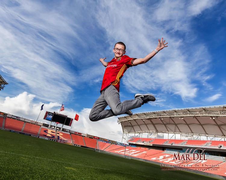Soccer player taking pictures in Real Salt Lake stadium